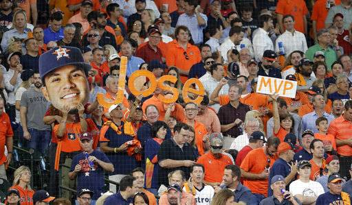 Fan show their support of Houston Astros' Jose Altuve after he hit his third home run of the day against the Boston Red Sox, during the seventh in Game 1 of a baseball American League Division Series, Thursday, Oct. 5, 2017, in Houston.