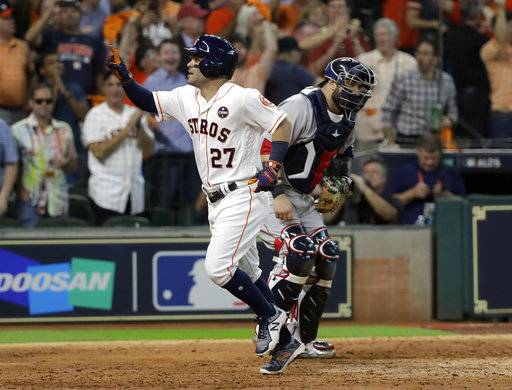 Houston Astros' Jose Altuve celebrates his solo home run, his third of the game, against the Boston Red Sox in the seventh inning in Game 1 of a baseball American League Division Series, Thursday, Oct. 5, 2017, in Houston.