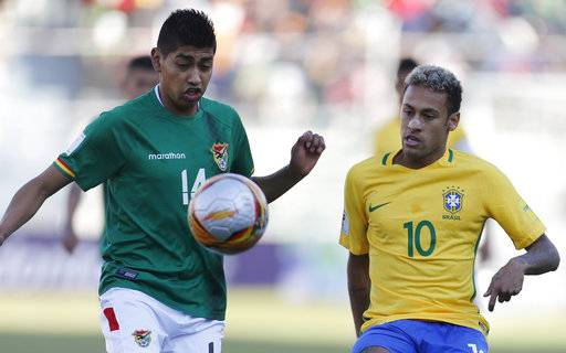 Bolivia's Raul Castro, left, fights for the ball with Brazil's Neymar during a World Cup qualifying soccer match in La Paz, Bolivia, Thursday, Oct. 5 2017.