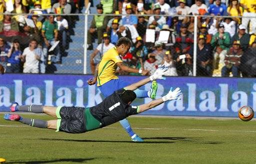 Bolivia goalkeeper Carlos Lampe (1) blocks a shot by Brazil's Neymar during a World Cup qualifying soccer match in La Paz, Bolivia, Thursday, Oct. 5 2017.