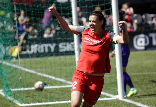 FILE - In this April 15, 2017, file photo, Portland Thorns forward Christine Sinclair celebrates scoring a goal during the second half of their NWSL soccer match against the Orlando Pride in Portland, Ore. The Thorns will host the third-place Pride in Portland on Saturday, Oct. 7, 2017, in their NWSL playoff semifinal game.