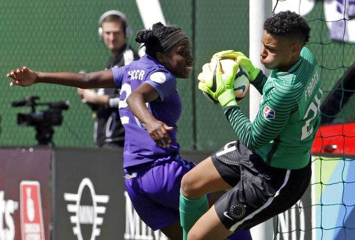 FILE - In this April 15, 2017, file photo, Portland Thorns goalie Adrianna Franch, right, stops a scoring attempt by Orlando Pride forward Jasmyne Spencer during the second half of their NWSL soccer match in Portland, Ore. The Thorns will host the third-place Pride in Portland on Saturday, Oct. 7, 2017, in their NWSL playoff semifinal game.