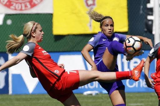 FILE - In this April 15, 2017, file  photo, Portland Thorns midfielder Lindsey Horan, left, and Orlando Pride defender Monica Hickmann Alves battle for the ball during the second half of their NWSL soccer match in Portland, Ore. The Thorns will host the third-place Pride in Portland on Saturday, Oct. 7, 2017, in their NWSL playoff semifinal game