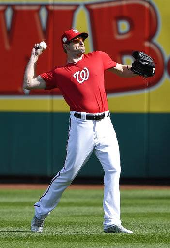 Washington Nationals' Max Scherzer throws during baseball practice at Nationals Park, Thursday, Oct. 5, 2017, in Washington. The Nationals host the Chicago Cubs in Game 1 of the National League Division Series on Friday.