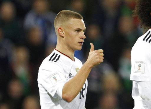 Germany's Joshua Kimmich celebrates scoring his side's third goal during the World Cup Group C qualifying soccer match between Northern Ireland and Germany at Windsor Park in Belfast, Northern Ireland, Thursday, Oct. 5, 2017.