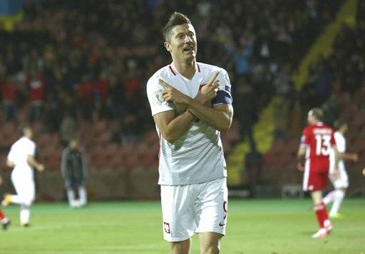 Poland's Robert Lewandowski celebrates scoring his goal during the World Cup Group E qualifying soccer match between Armenia and Poland in Yerevan, Armenia, Thursday, Oct. 5, 2017. (Hrant Khachatryan/PAN Photo via AP)