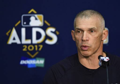 New York Yankees manager Joe Girardi answers questions before Game 1 of baseball's American League Division Series against the Cleveland Indians, Thursday, Oct. 5, 2017, in Cleveland.
