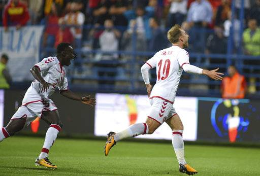 Denmark's Christian Eriksen, right, celebrates with Pione Sisto after scoring the first goal of his team during their World Cup Group E qualifying soccer match against Montenegro, at the City Stadium in Podorica, Montenegro, Thursday, Oct. 5, 2017.