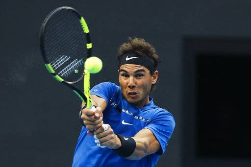 Rafael Nadal of Spain hits a return shot against Karen Khachanov of Russia during their second round of the men's singles match in the China Open tennis tournament at the Diamond Court in Beijing, Thursday, Oct. 5, 2017.