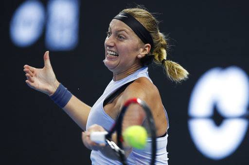 Petra Kvitova of the Czech Republic returns a shot against Caroline Wozniacki of Denmark during their third round of the women's singles match in the China Open tennis tournament at the Diamond Court in Beijing, Thursday, Oct. 5, 2017.