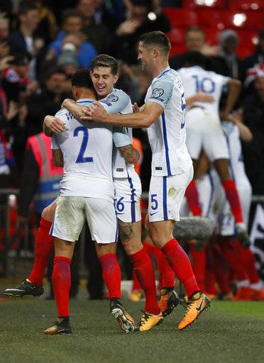 England players celebrate after scoring a goal during the World Cup Group F qualifying soccer match between England and Slovenia at Wembley stadium in London, Thursday, Oct. 5, 2017. England won 1-0 and qualified for the tournament finals.