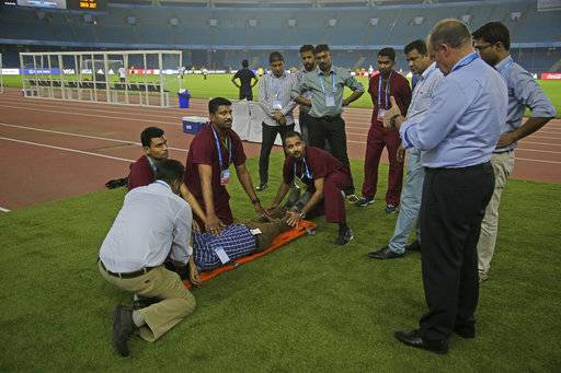 Paramedics undergo a mock drill to evacuate injured at Jawaharlal Nehru Stadium, one of the venues for the FIFA U-17 World Cup in New Delhi, India, Wednesday, Oct. 4, 2017.