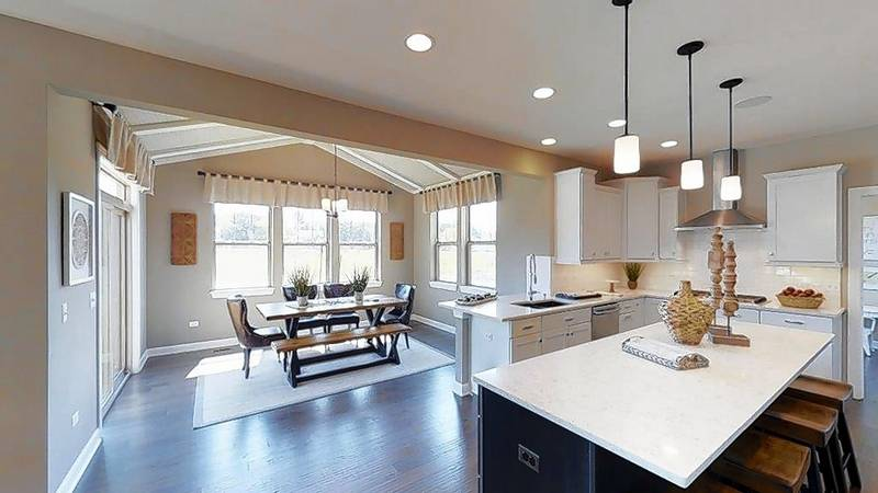 william ryan homes offers a signature morning room with a vaulted ceiling