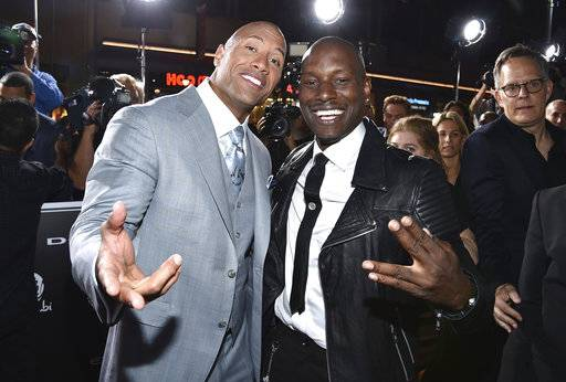 "FILE - In this April 1, 2015, file photo, Dwayne Johnson, left, and Tyrese Gibson arrive at the premiere of ""Furious 7"" at the TCL Chinese Theatre IMAX in Los Angeles. Tyrese posted on Instagram Thursday, Oct. 5, 2017, that Johnson was a ""clown"" for agreeing to star in a spinoff film in the ""Fast & Furious� franchise. (Photo by John Shearer/Invision/AP, File )"