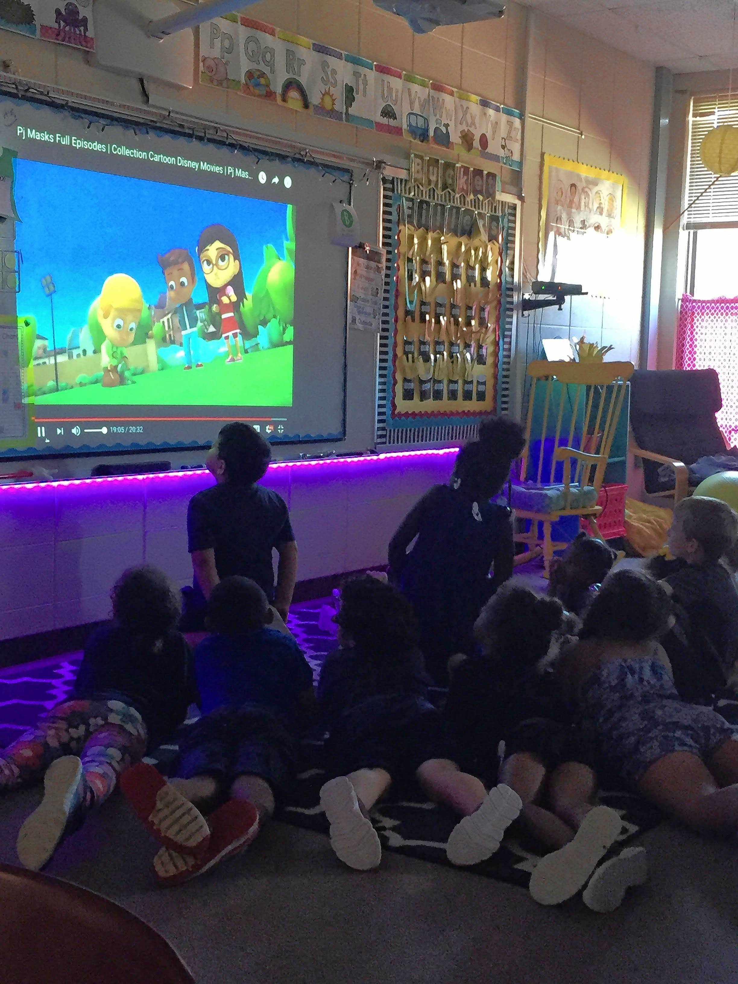 "Courtesy of Spaulding School Spaulding students watch ""PJ Masks,"" a video about superhero children who work together."