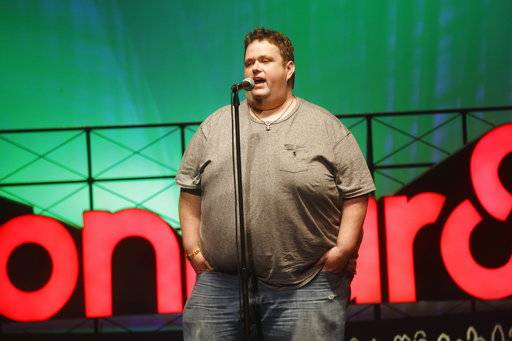 FILE - In this June 13, 2015 file photo, Ralphie May performs at the 2015 Bonnaroo Music and Arts Festival in Manchester, Tenn. A spokeswoman for Ralphie May says the comedian has died at age 45. In a statement Friday, Oct. 6, 2017, publicist Stacey Pokluda said May died of cardiac arrest. She said he had been fighting pneumonia, which caused him to cancel a few appearances in the past month. (Photo by John Davisson/Invision/AP, File)