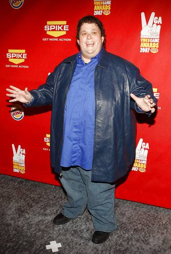 FILE - In this Dec. 7, 2007 file photo, Ralphie May arrives at the Spike TV Video Game Awards at Mandalay Bay Hotel & Casino, in Las Vegas. A spokeswoman for May says the comedian has died at age 45. In a statement Friday, Oct. 6, 2017, publicist Stacey Pokluda said May died of cardiac arrest. She said he had been fighting pneumonia, which caused him to cancel a few appearances in the past month.