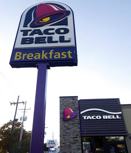 FILE - This Dec. 15, 2016, file photo shows a Taco Bell restaurant in Metairie, La. Robert L. McKay, who designed the first Taco Bell restaurant and with founder Glenn Bell turned it from a quirky food stand into a fast-food empire, died last week. He was 86.