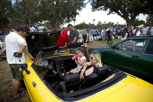 "People look at antique cars during the 31st annual ""Five Club"" collectors car meeting in Ramat Gan, Israel, Friday, Oct. 6, 2017. Each weekend, at Israeli gas stations and parking lots and parks, car collectors gather with their beauties _ and take a step back in time"