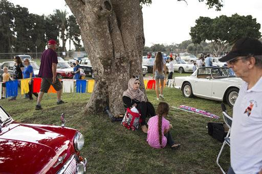 "People look at antique cars during the 31st annual ""Five Club"" collectors cars meeting in Ramat Gan, Israel, Friday, Oct. 6, 2017."