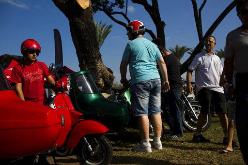 "People park their antique scooters during the 31st annual ""Five Club"" car collectors' meeting in Ramat Gan, Israel, Friday, Oct. 6, 2017. Each weekend, at Israeli gas stations and parking lots and parks, car collectors gather with their beauties _ and take a step back in time."