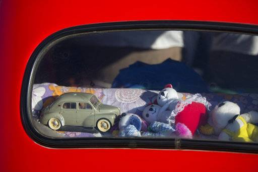 "Toys placed in the back of an antique car during the 31st annual ""Five Club"" car collectors' meeting in Ramat Gan, Israel, Friday, Oct. 6, 2017. Each weekend, at Israeli gas stations and parking lots and parks, car collectors gather with their beauties _ and take a step back in time."