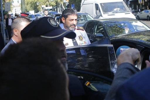 Catalan regional police chief Josep Luis Trapero gets into a car after leaving the national court in Madrid, Spain, Friday, Oct. 6, 2017. Spain's National Court is questioning two senior officers of Catalonia's regional police force and the leaders of two pro-independence civic groups who have been placed under investigation for sedition, a case over preparations for an Oct. 1 referendum on independence.