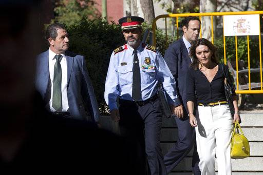 Catalan regional police chief Josep Luis Trapero leaves the national court in Madrid, Spain, Friday, Oct. 6, 2017. Spain's National Court is questioning two senior officers of Catalonia's regional police force and the leaders of two pro-independence civic groups who have been placed under investigation for sedition, a case over preparations for an Oct. 1 referendum on independence.