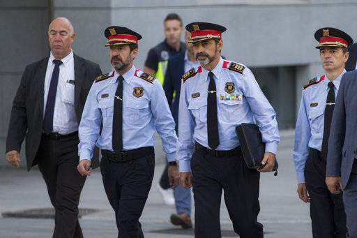 Catalan regional police chief Josep Luis Trapero, 3rd left, arrives at the national court in Madrid, Spain, Friday, Oct. 6, 2017. A Spanish judge is due to question Mossos d'Esquadra chief Trapero and two pro-independence campaigners about their role in an Oct. 1 referendum that the Spanish government declared as illegal.