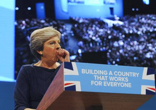 Conservative Party Leader and Prime Minister, Theresa May, coughs during her address to delegates at the Conservative Party Conference at Manchester Central, in Manchester, England, Wednesday, Oct. 4, 2017.