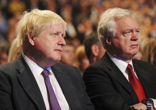 Secretary of State for Foreign and Commonwealth Affairs Boris Johnson, left, and Secretary of State for Exiting the European Union David Davies, right, listen during Conservative Party Leader and Prime Minister Theresa May's speech at the Conservative Party Conference at Manchester Central, in Manchester, England, Wednesday, Oct. 4, 2017.