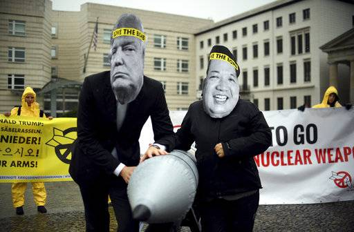 "FILE - in this Sept. 13, 2017 file photo activists of the International Campaign to Abolish Nuclear Weapons (ICAN) protest against the conflict between North Korea and the USA with masks of the North Korean ruler Kim Jong Un, right, and the US president Donald Trump, left,  in front of the US embassy in Berlin, Germany. The International Campaign to Abolish Nuclear Weapons wins the Nobel Peace Prize. The Norwegian Nobel Committee honored the Geneva-based group ""for its work to draw attention to the catastrophic humanitarian consequences of any use of nuclear weapons and for its ground-breaking efforts to achieve a treaty-based prohibition of such weapons."" (Britta Pedersen/dpa via AP)"