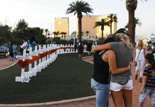A memorial displaying 58 crosses by Greg Zanis stands at the Welcome To Las Vegas Sign on Thursday, October 5, 2017, in Las Vegas. Each cross has the name of a victim killed during the mass shooting at the Route 91 Harvest country music festival this past Sunday. Dozens of people were killed and hundreds were injured.  (Mikayla Whitmore/Las Vegas Sun via AP)