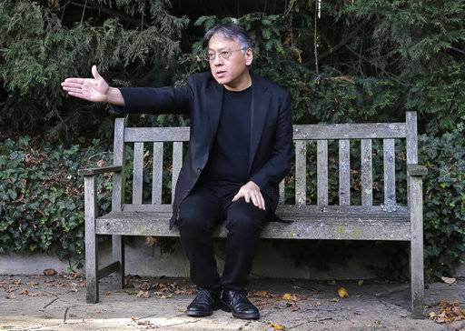 "British novelist Kazuo Ishiguro gestures during a press conference at his home in London, Thursday Oct. 5, 2017. Ishiguro, best known for ""The Remains of the Day,"" won the Nobel Literature Prize on Thursday, marking a return to traditional literature following two years of unconventional choices by the Swedish Academy for the 9-million-kronor ($1.1 million) prize."