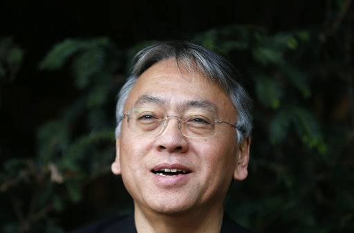 "British novelist Kazuo Ishiguro smiles during a press conference at his home in London, Thursday Oct. 5, 2017. Ishiguro, best known for ""The Remains of the Day,"" won the Nobel Literature Prize on Thursday, marking a return to traditional literature following two years of unconventional choices by the Swedish Academy for the 9-million-kronor ($1.1 million) prize."