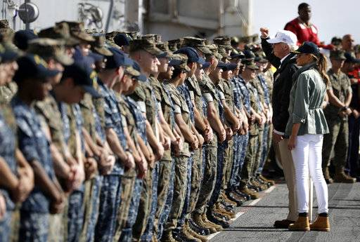 President Donald Trump and first lady Melania Trump greet military members on the USS Kearsarge off the coast of San Juan, Puerto Rico, Tuesday, Oct. 3, 2017.