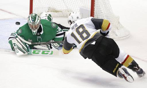 Vegas Golden Knights left wing James Neal (18) scores a goal against Dallas Stars goalie Kari Lehtonen (32) during the third period of an NHL hockey game in Dallas, Friday, Oct. 6, 2017. The Golden Knights won 2-1.