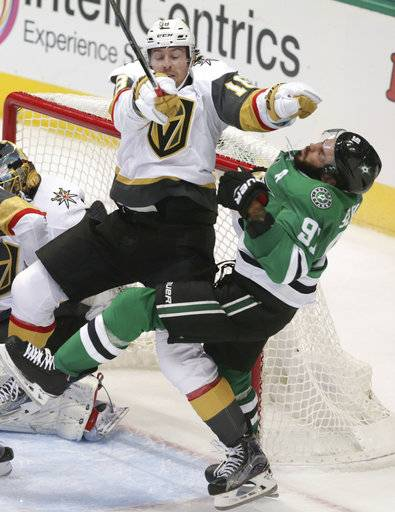 Vegas Golden Knights' James Neal (18) hits Dallas Stars center Tyler Seguin (91) in front of the goal during the second period of an NHL hockey game in Dallas, Friday, Oct. 6, 2017. The Golden Knights won 2-1.