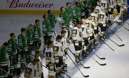 The Dallas Stars and Vegas Golden Knights line up for a moment of silence for shooting victims in Las Vegas before an NHL hockey game in Dallas, Friday, Oct. 6, 2017.