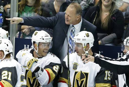 Vegas Golden Knights coach Gerard Gallant points from the bench, behind center Jonathan Marchessault (81) and right wing Reilly Smith (19) during the third period of an NHL hockey game against the Dallas Stars in Dallas, Friday, Oct. 6, 2017. The Golden Knights won 2-1.