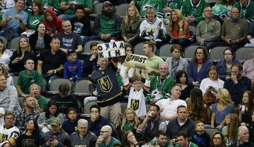 Vegas Golden Knights fans celebrate a goal scored by James Neal during the third period of an NHL hockey game against the Dallas Stars in Dallas, Friday, Oct. 6, 2017. The Golden Knights won 2-1.