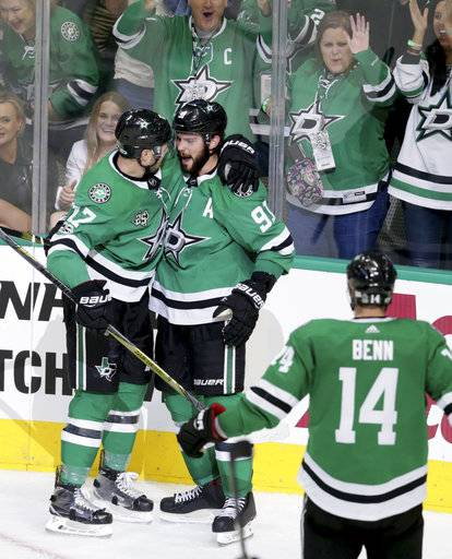Dallas Stars center Tyler Seguin (91) celebrates his goal with Devin Shore (17) and Jamie Benn (14) during the second period of an NHL hockey game against the Vegas Golden Knights in Dallas, Friday, Oct. 6, 2017.