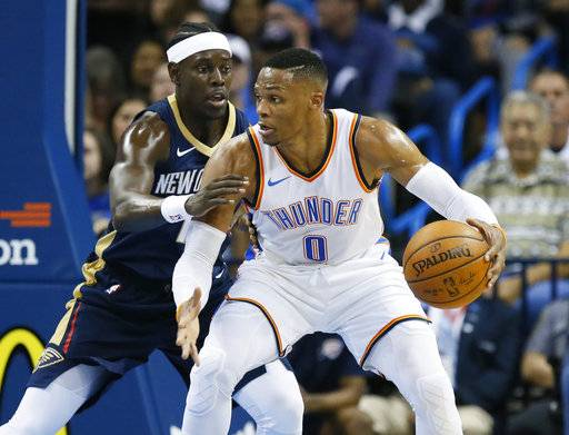 Oklahoma City Thunder guard Russell Westbrook (0) drives against New Orleans Pelicans guard Jrue Holiday, left, during the first quarter of an NBA preseason basketball game in Oklahoma City, Friday, Oct. 6, 2017.