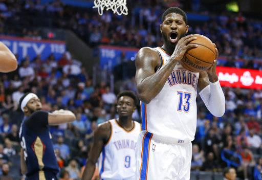 Oklahoma City Thunder forward Paul George (13) reacts after being called for a foul during the second quarter of an NBA preseason basketball game against the New Orleans Pelicans in Oklahoma City, Friday, Oct. 6, 2017.
