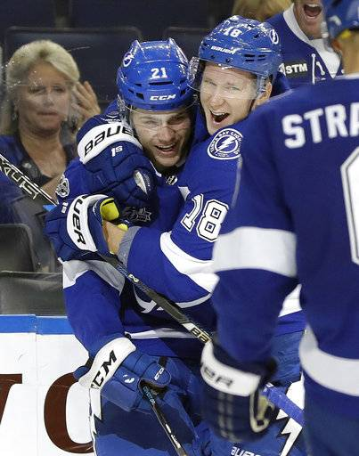 Tampa Bay Lightning center Brayden Point (21) gets a hug from left wing Ondrej Palat (18), of the Czech Republic, after Point scored against the Florida Panthers during the second period of an NHL hockey game Friday, Oct. 6, 2017, in Tampa, Fla.
