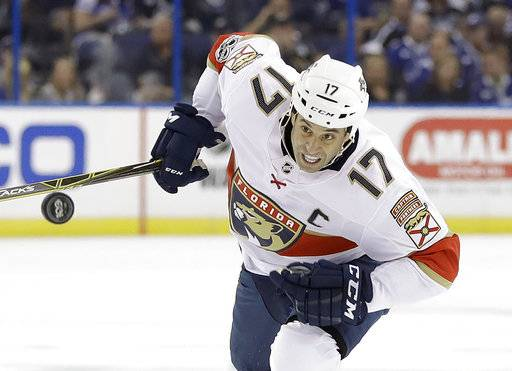 Florida Panthers center Derek MacKenzie chases the puck during the first period of an NHL hockey game against the Tampa Bay Lightning on Friday, Oct. 6, 2017, in Tampa, Fla.
