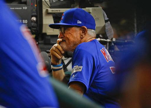Chicago Cubs manager Joe Maddon watches from the dugout the final out of the fifth inning during in Game 1 of baseball's National League Division Series against the Washington Nationals at Nationals Park, Friday, Oct. 6, 2017, in Washington.