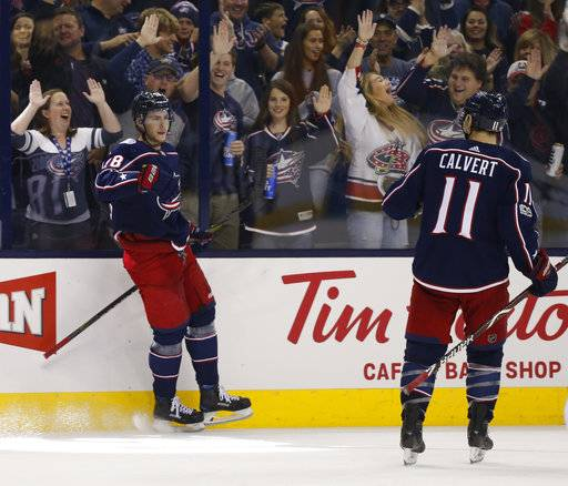 Columbus Blue Jackets' Pierre-Luc Dubois, left, celebrates his goal against the New York Islanders during the second period of an NHL hockey game Friday, Oct. 6, 2017, in Columbus, Ohio.