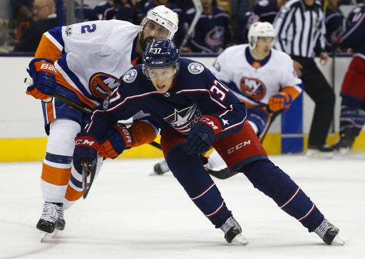Columbus Blue Jackets' Markus Hannikainen, right, of Finland, skates past New York Islanders' Nick Leddy during the second period of an NHL hockey game Friday, Oct. 6, 2017, in Columbus, Ohio.