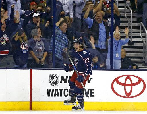 Columbus Blue Jackets' Sonny Milano celebrates his goal against the New York Islanders during the first period of an NHL hockey game Friday, Oct. 6, 2017, in Columbus, Ohio.